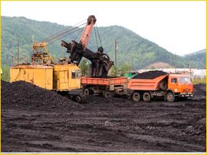 Экскаватор и добыча угля погрузкой в КАМАЗ
