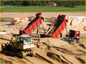 Доставка песка для строительства дороги